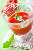 Tomato juice with fresh basil Stock Image