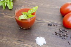 Tomato juice. Fresh tomato juice, herbs and spices on wooden table stock images