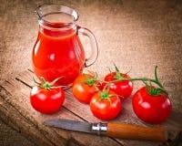 Tomato juice and fresh organic tomatoes Stock Photos