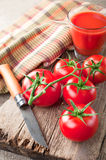 Tomato juice and fresh tomatoes Stock Images