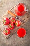 Tomato juice and fresh tomatoes Royalty Free Stock Photos