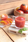 Tomato juice and fresh tomatoes Stock Photography