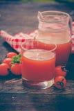 Tomato juice. Fresh tomato juice and tomatoes Royalty Free Stock Images