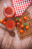 Tomato juice. Fresh tomato juice and tomatoes Royalty Free Stock Photography