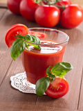 Tomato juice. With fresh tomatoes in the background Stock Photography