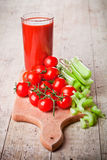 Tomato juice, fresh tomatoes and celery Royalty Free Stock Photography