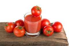 Tomato juice with fresh tomatoes Stock Photography