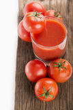 Tomato juice with fresh tomatoes Royalty Free Stock Images