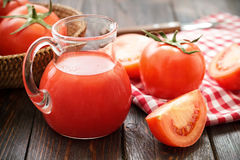 Tomato juice. And fresh vegetables on a wooden table Royalty Free Stock Photography