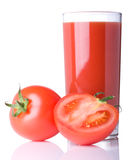 Tomato juice in glass. On white background Royalty Free Stock Image
