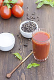 Tomato juice in glass with basil, spices and tomatoes cherry Stock Images
