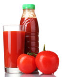 Tomato juice in glass, bottle and tomato Stock Images