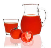 Tomato juice in glass and carafe Royalty Free Stock Photos