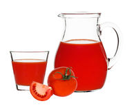 Tomato juice in glass and carafe Stock Images