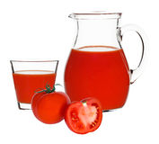 Tomato juice in glass and carafe Stock Image