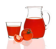 Tomato juice in glass and carafe Royalty Free Stock Image