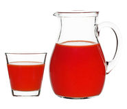 Tomato juice in a glass and a carafe Stock Image