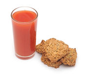 Tomato juice glass with cookies Stock Photography