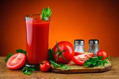 Tomato juice. Glass of tomato juice and ingredients Stock Images