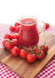 Tomato juice in glass jug Stock Image