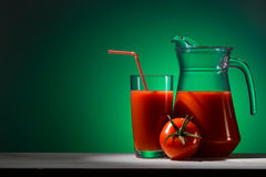 Tomato juice in a glass and jug Stock Photo