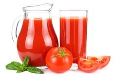 Tomato juice in glass jug isolated on white background royalty free stock photos