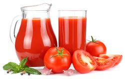 Tomato juice in glass jug isolated on white background royalty free stock images