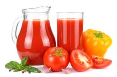Tomato juice in glass jug isolated on white background stock images
