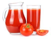 Tomato juice in glass jug isolated on white background stock image