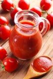 Tomato juice in glass jug Stock Image