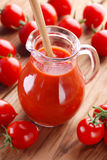 Tomato juice in glass jug Royalty Free Stock Image