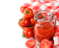 Tomato juice. In a glass jug on white background Stock Images