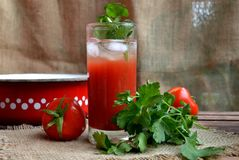Tomato juice in a glass. Red tomato juice in a glass Stock Photography