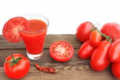 Tomato Juice in glass and ripe tomatoes Royalty Free Stock Photo