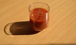Tomato juice. In a glass on the table Royalty Free Stock Image