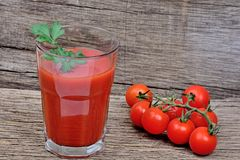 Tomato juice in a glass on table Stock Photography