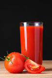 Tomato juice in glass and tomato Royalty Free Stock Images