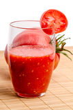 Tomato juice in a glass and tomatoes Stock Photography