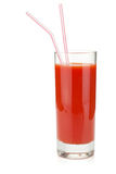 Tomato juice in glass with two drinking straws Stock Photography
