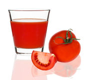 Tomato juice in a glass on a white background Royalty Free Stock Photography