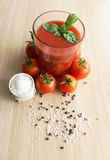 Tomato juice in a glass. On a wooden surface Royalty Free Stock Image