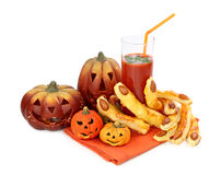 Tomato juice and halloween cakes Stock Images