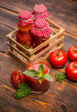Tomato juice. Homemade tomato juice in a glass on a wooden table Royalty Free Stock Photo