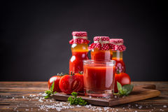 Tomato juice. Homemade tomato juice on wooden board Royalty Free Stock Photos