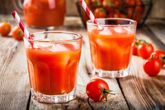 Tomato juice with ice in glasses Royalty Free Stock Images
