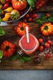 Tomato juice in mason jar. On wooden rustic board Stock Photos