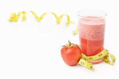 Tomato and juice with measuring tape Royalty Free Stock Photos