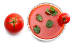 Tomato juice with mint leaf isolated on white background. top view royalty free stock images