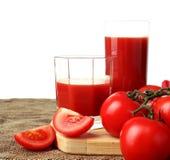 Tomato juice pour into glasses Stock Photo