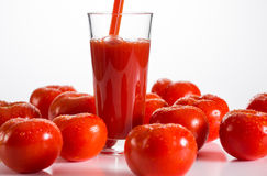 Tomato juice. Pouring a glass of tomato juice Stock Photography